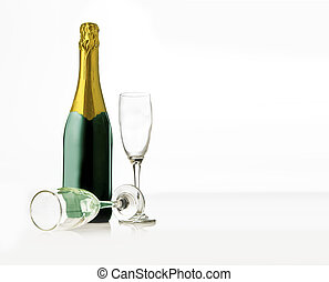 Pair of glasses and champagne bottle isolated over white background