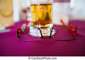 pair of glasses lying on a table
