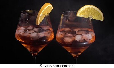 Pair of glasses with alcoholic drink beverage wine cocktail...