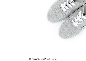 Pair of grey shoes on white background