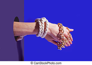 Pair of hands tied by rope and golden chain - Close up pair ...