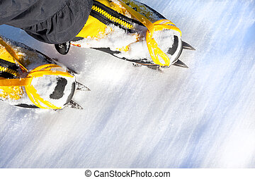 Pair of high mountain boots with crampons in the snow.