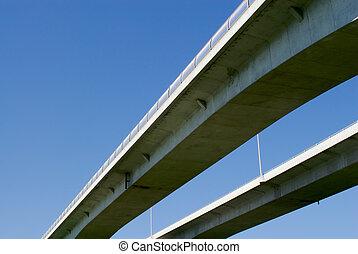Pair of highway bridges on blue sky