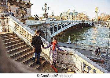 pair of lovers on Seine river in Paris. travel in spring in Europe.