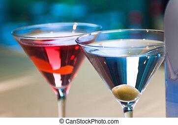 Pair of martini glasses at a bar