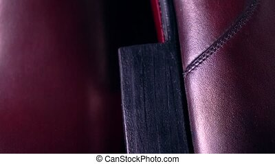 Pair of new classic mens boots. 4K pan telephoto lens shot