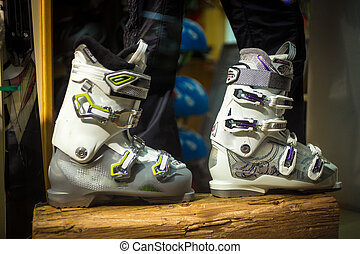 Pair of new ski boots on wooden board