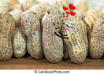 pair of peanuts in love - Peanuts hugging in a nutty crowd.