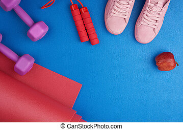 pair of pink training sneakers with laces, purple plastic dumbbells