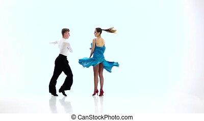 Pair of professional dancers perform rumba, white...