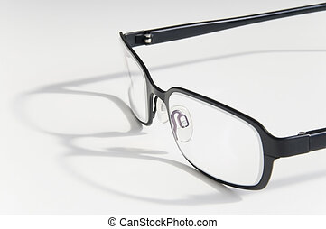 reading glasses - Pair of reading glasses, closeup over ...