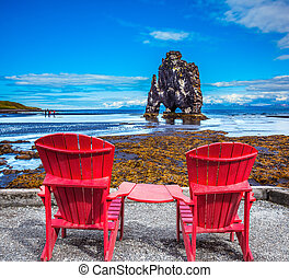 Pair of red deck chairs and Rock Hvitsercur