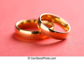 Pair Of Rings - Pair Of Golden Rings Over Orange Background