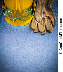 Pair of safety leather gloves building helmet and protective gog
