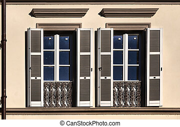 Pair of shuttered windows on a building in Lecco