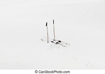 Pair of skis in snow white background