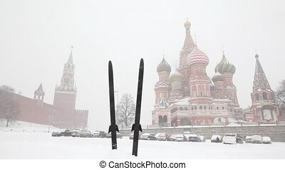 Pair of skis stacked vertically into snowdrift near Red Square