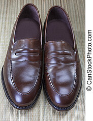 Pair of Stylish Expensive Modern Calf Leather Brown Penny Loafers Shoes.Closeup Shot.