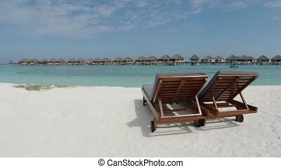 Pair of Sun Loungers in the Sand in the Maldives - Two...