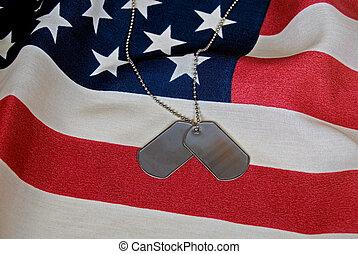 Military dog tags on flag.