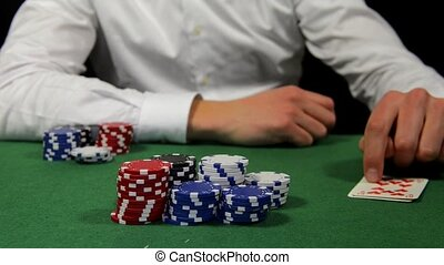 Pair of tens - Poker player winning the pot with a pair of...