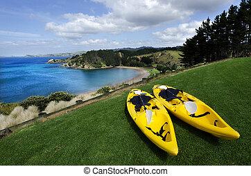 Pair of twin yellow kayaks