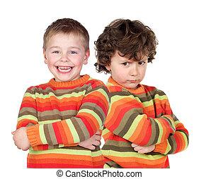 Pair of twins dressed alike