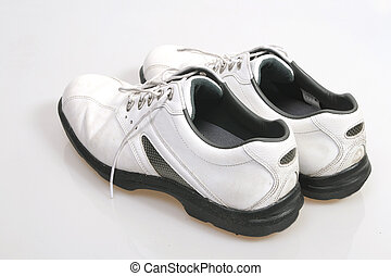 Pair of white golf shoes