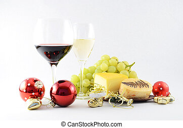 Pair of wineglasses, grapes, cheese and christmas tree toys
