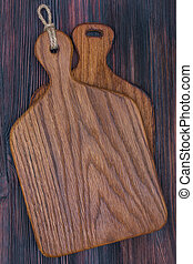 Pair of wooden oak cutting boards on a old rustic surface, top view, close up.