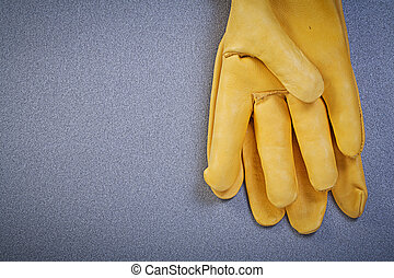 Pair of working safety gloves on grey background construction co