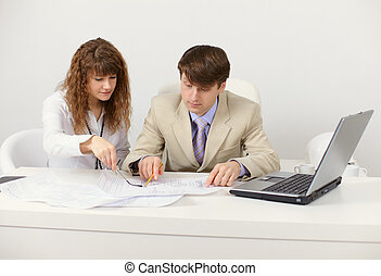 Pair of young businessmen in workplace