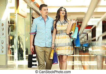 Pair of young people in a shopping center
