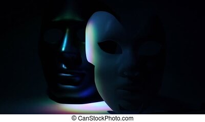 Pair theatrical masks black and white lit by color light at...