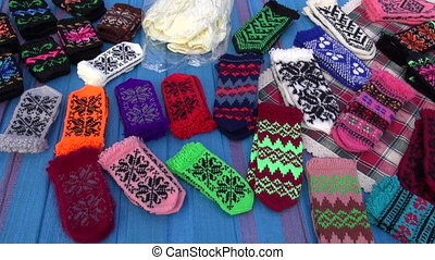 pairs knitted mittens - pairs of multicolored knitted...