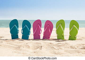 Pairs Of Flip-flops On Beach - Colorful Three Pairs Of...
