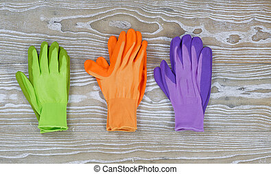 Pairs of Garden Gloves on Rustic Wood