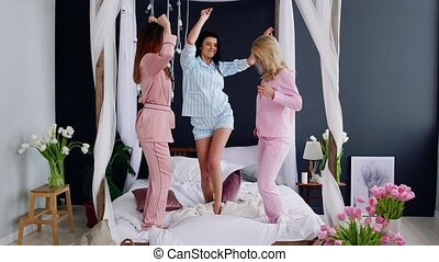 Pajama party before the wedding three bridesmaids dance on...