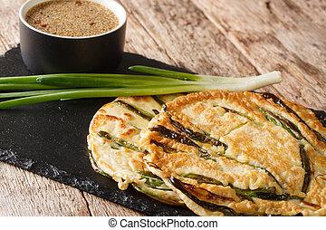 Pajeon Korean Scallion Pancakes with sauce close-up on a ...