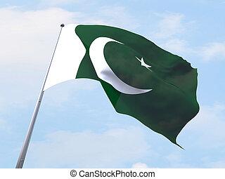 Pakistan flag flying on clear sky.