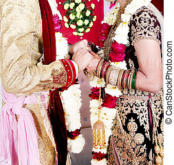 Pakistani Indian bride & Groom holding hands wedding portrait
