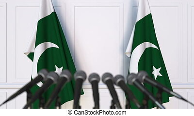 Pakistani official press conference with flags of Pakistan....
