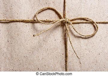 pakket, gewikkelde in bruin papier, en, gebonden, met, twijn