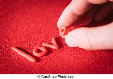 palabra, amor, con, rojo, cartas, en, un, fondo rojo