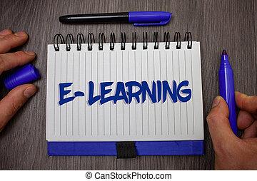 palabra, escritura, texto, e-learning., concepto de la corporación mercantil, para, educación, por, internet, distante, educación, tela, cursos, estudios, hombre, asimiento, tenencia, azul, marcador, cuaderno, página, papel, ideas, de madera, fondo.