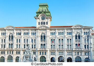 Palace and old buildings on city square in Trieste, Italy