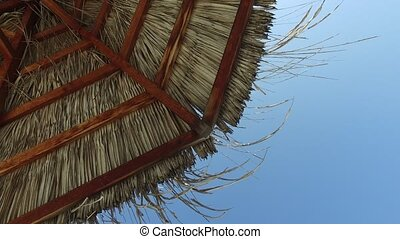 palapa or bungalow straw shed over blue sky - travel,...