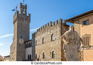 Palazzo dei Priori and its clock tower. Seat of the Town Hall of Arezzo, is located in Piazza della Liberta'. Built in the 14th century, Arezzo, Tuscany, Italy