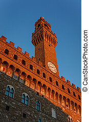 Palazzo Vecchio tower in the evening sun Florence
