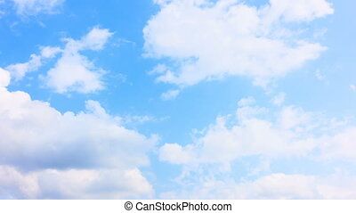 Pale blue sky. Timelapse - White clouds moving across pale...